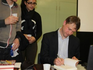 "Danil signs his book """"The History and Philosophy of Kung Fu: An Introduction"""