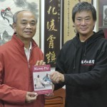 Dennis Ngo presents Su Ying Han with his signed copy of Danil Mikhailov's book
