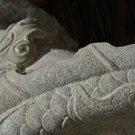 Stone dragon wrapped around a pillar