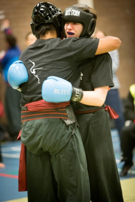 Two competitors embrace at the end of a sparring round at the Fujian White Crane Kung Fu Competition February 2015