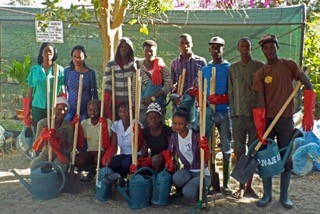 Aspyre Africa 1st cohort of horticultural students with tools provided from a donation by FWC Kung Fu