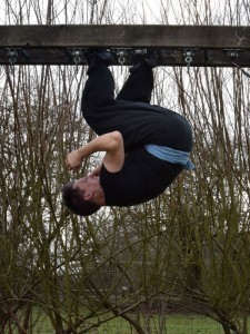 FWC Kung Fu Instructor Adam Prout doing upside down squats