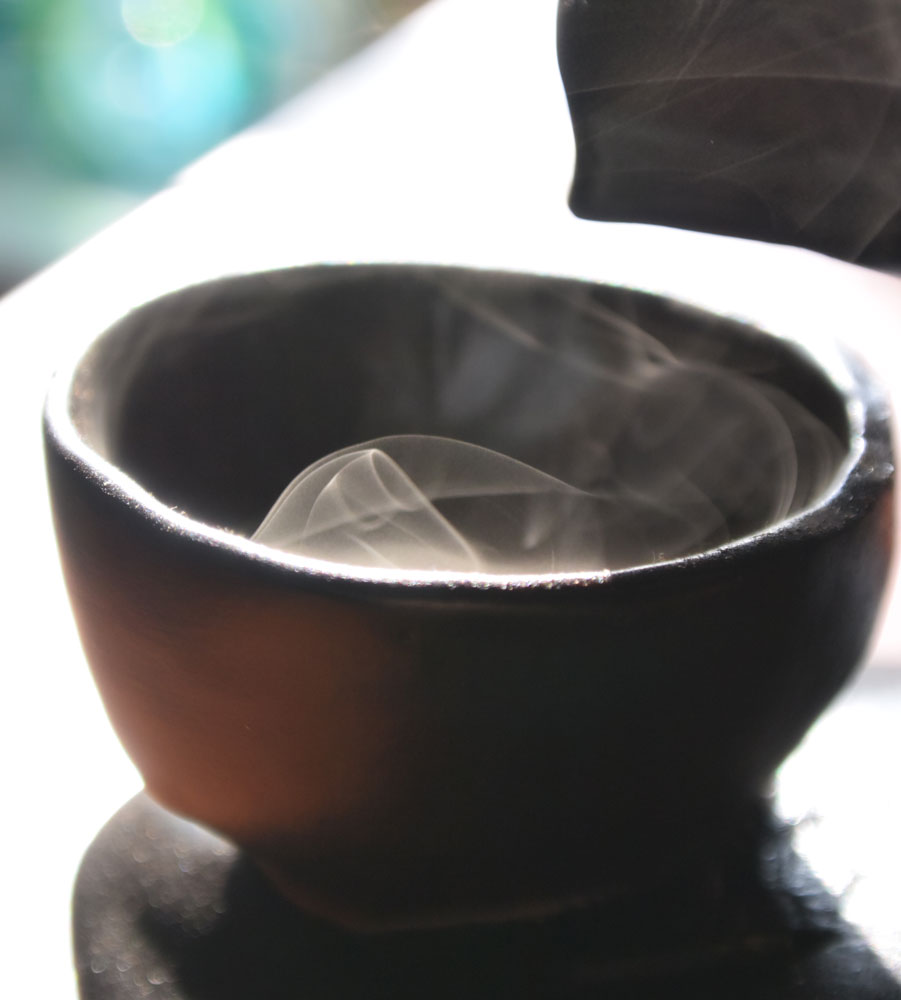 A residue of smoke swirling inside a chinese tea cup