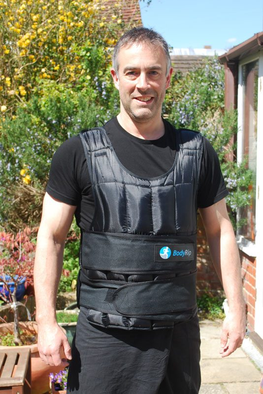 Instructor Dave Courtney Jones standing in his 30kg weighted vest.