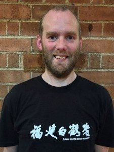 Photo of the author, Tim Rutherford-Johnson, wearing his FWC kung fu uniform