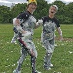 After emerging from a foam bath two of the laughing runners continue at the Gauntlet Games