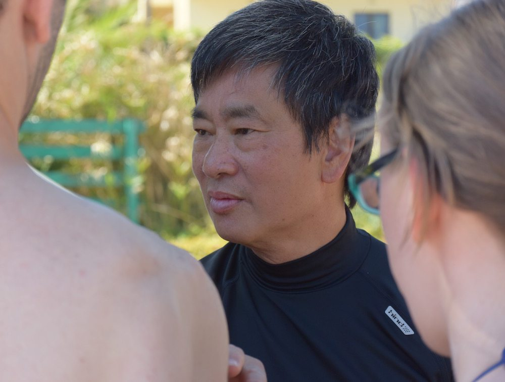 Instructor Dennis Ngo of the Fujian White Crane Kung Fu & Tai Chi Martial Arts Club teaching his students on a beach in Crete