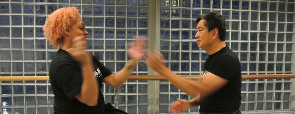 Crystal practises blocking with Dennis Ngo, Chief Instructor Fujian White Crane Kung Fu & Tai Chi Martial Arts