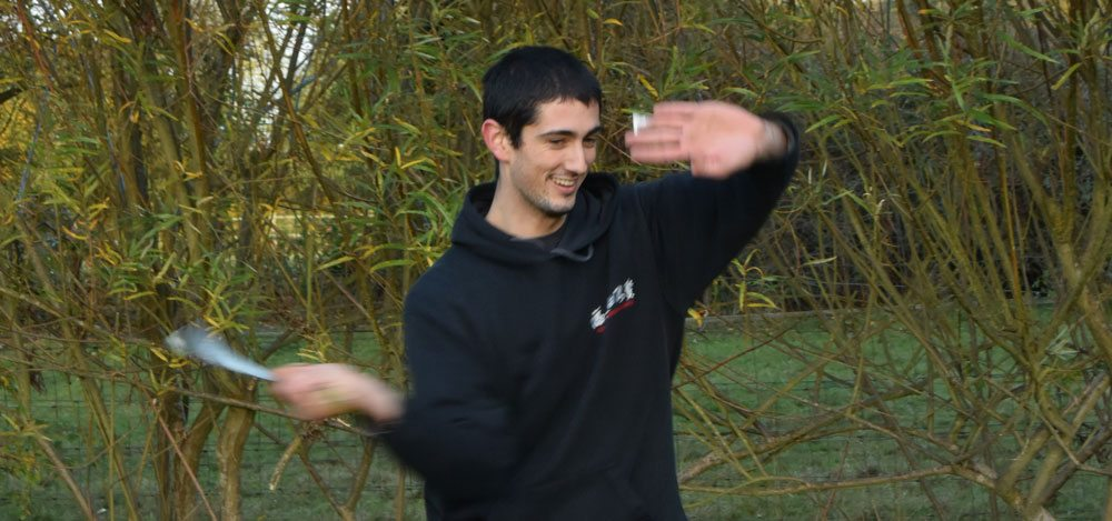 Instructor Joshua Villar, Fujian White Crane Kung & Tai Chi Martial Arts, clearly enjoying Chinese broadsword practice