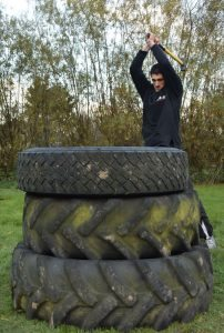 Joshua Villar, Instructor, Fujian White Crane Kung Fu & Tai Chi Martial Arts, practising the Thor hammer techniques of a sledgehammer on lorry tyres