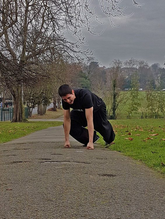 Joshua Villar, Instructor, Fujian White Crane Kung Fu & Tai Chi Martial Arts, on a painful change of ground during his knuckle walk training challenge