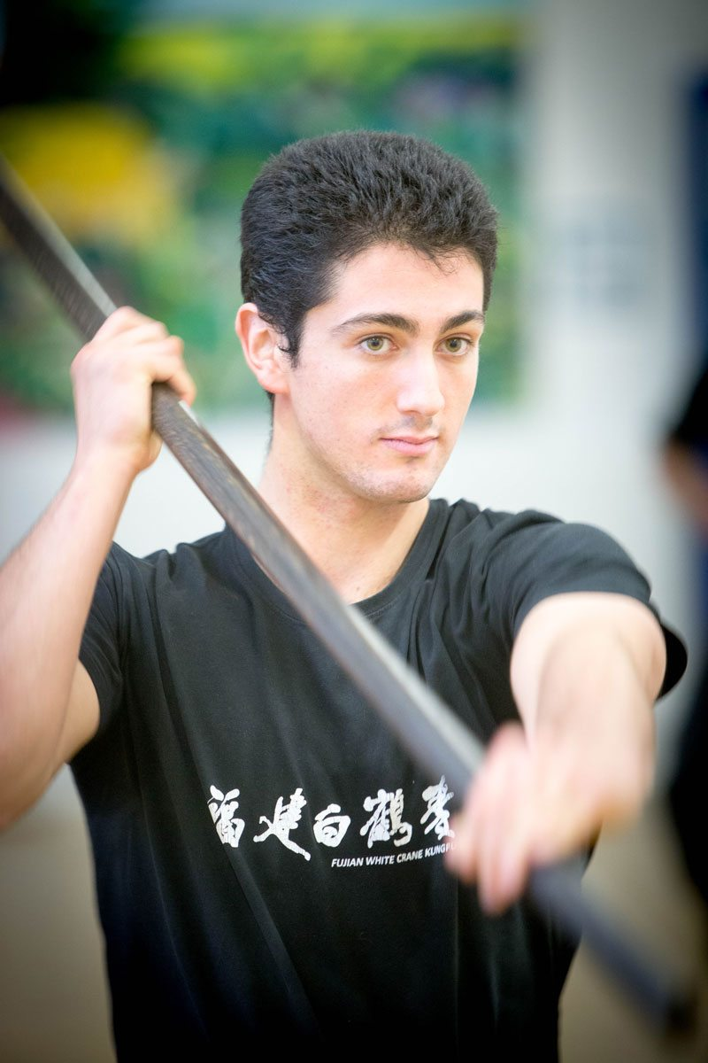 Joshua Villar, Instructor, Fujian White Crane Kung Fu & Tai Chi Club, wooden staff.