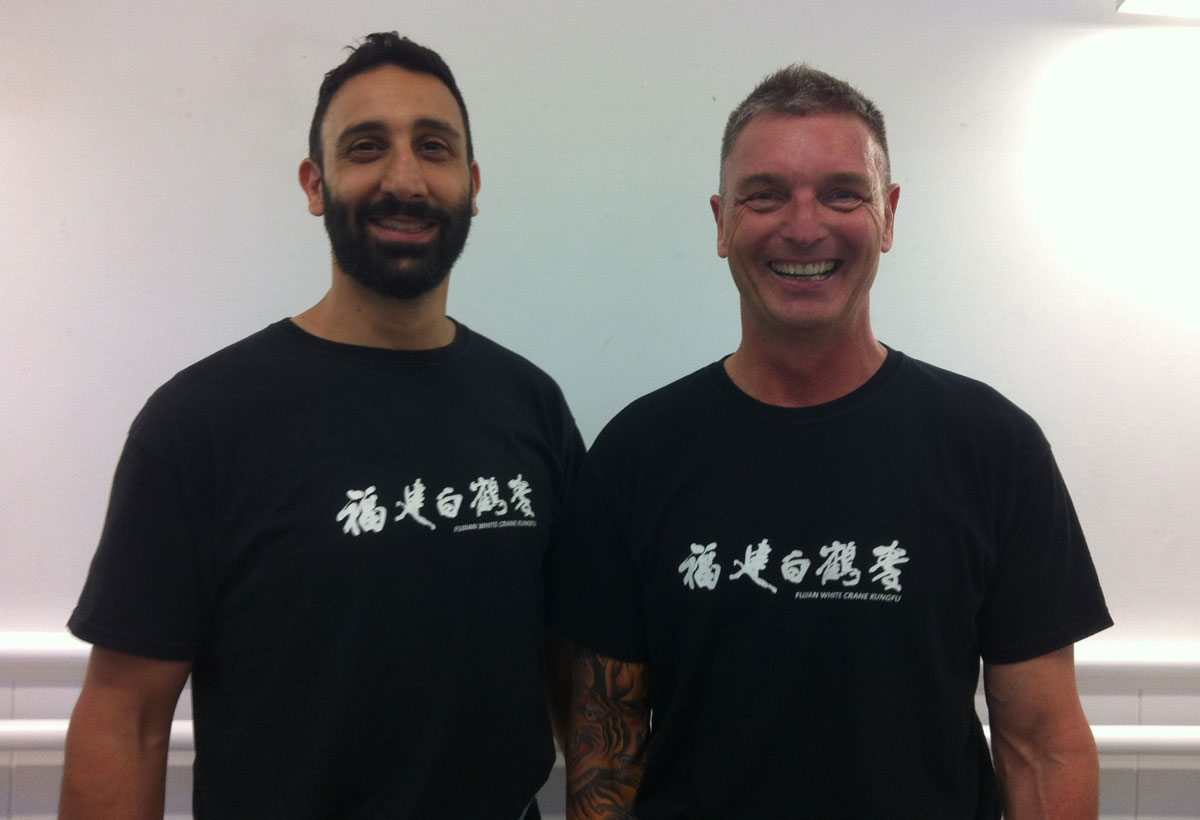 Karim Daoud and Gary Oliver, in Kung Fu uniform side by side. Karim Daoud is an Instructor of the Fujian White Crane Kung Fu & Tai Chi Martial Arts Club