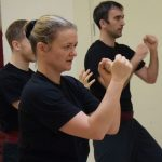 Instructor Anna Wallen in guard position. during instructor training at the Fujian White Crane Kung Fu & Tai Chi Martial Arts Club (FWC Kung Fu).