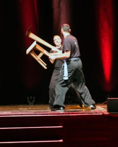Dave Courtney Jones (Hoe) and Karim Daoud, (Stool), perform a two-person weapons pattern at the Fujian White Crane Kung Fu & Tai Chi Martial Arts Club (FWC Kung Fu) 40th Anniversary Celebration