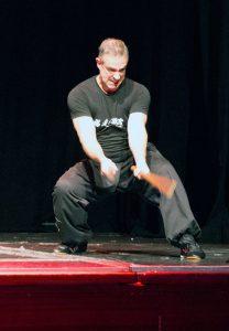 Dave Courtney Jones, Instructor, Fujian White Crane Kung Fu & Tia Chi Martial Arts Club (FWC Kung Fu), performs twin sticks pattern at the Club's 40th Anniversary Celebration