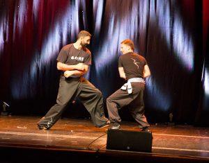 Karim Daoud and Adam Prout, Instructors of the Fujian White Crane Kung Fu & Tai Chi Martial Arts Club (FWC Kung Fu) perform a two-person fighting pattern at the Club's 40th Anniversary Celebration