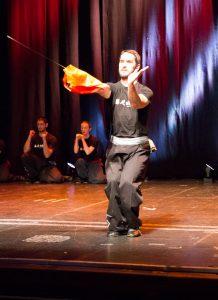 Richard Wagstaff, Instructor, Fujian White Crane Kung Fu & Tai Chi Martial Arts Club (FWC Kung Fu), performs a broadsword pattern at the Club's 40th Anniversary Celebration