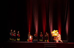 Traditional Chinese Lion Dance performance on stage at the 40th Anniversary Celebration of the Fujian White Crane Kung Fu & Tai Chi Martial Arts Club (FWC Kung Fu).