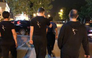 The Fujian White Crane Kung Fu Club walking through Yongchun at night